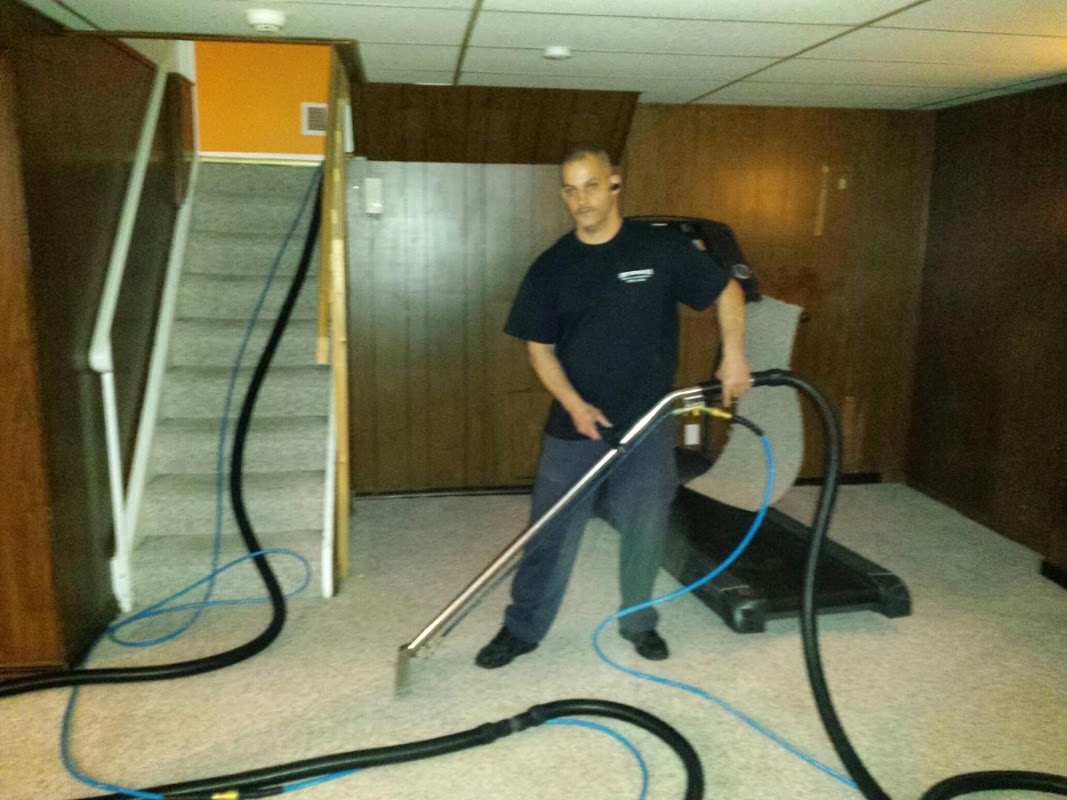 alan cleaning carpet in a basement